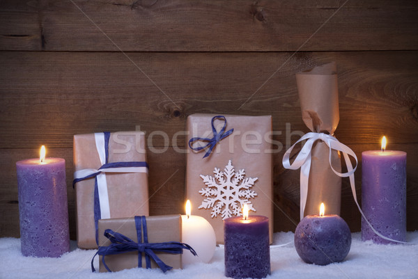 Stock photo: Purple Christmas Gifts With Candles, Snow