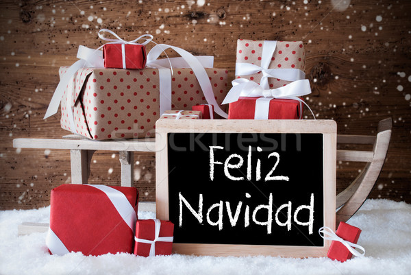 Sleigh With Gifts, Snow, Snowflakes, Feliz Navidad Means Merry C Stock photo © Nelosa