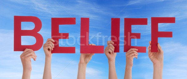 Hands Holding Red Belief Stock photo © Nelosa