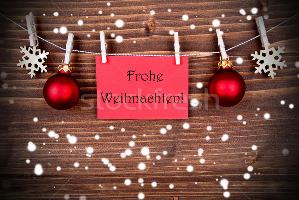 Frohe Weihnachten on a Red Banner in the Snow Stock photo © Nelosa