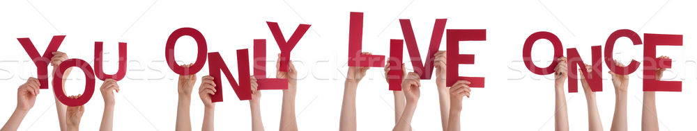 Hands Holding Red Word You Only Live Once  Stock photo © Nelosa