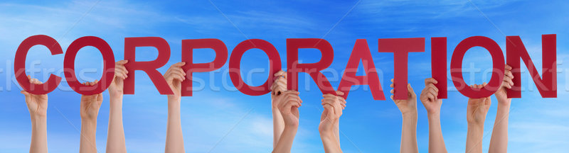 Hands Holding Red Straight Word Corporation Blue Sky Stock photo © Nelosa