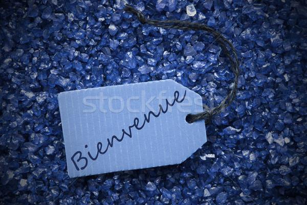Purple Stones With Label Bienvenue Means Welcome Stock photo © Nelosa