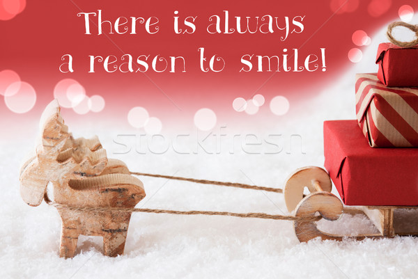 Reindeer With Sled, Red Background, Quote Always Reason Smile Stock photo © Nelosa