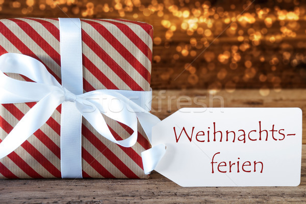 Atmospheric Gift With Label, Weihnachtsferien Means Christmas Br Stock photo © Nelosa