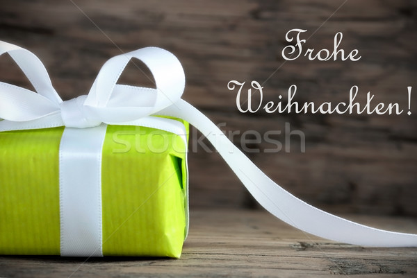 Green Present with Frohe Weihnachten Stock photo © Nelosa