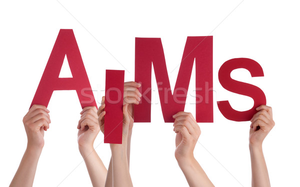 Many People Hands Holding Red Word Aims  Stock photo © Nelosa