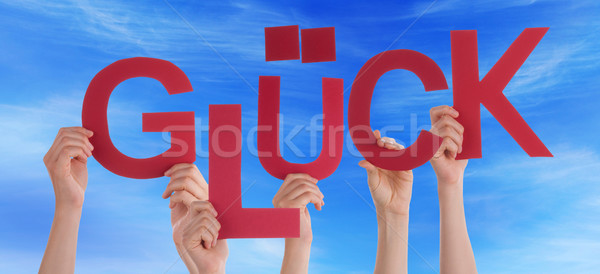 People Hold German Word Glueck Means Luck Blue Sky Stock photo © Nelosa