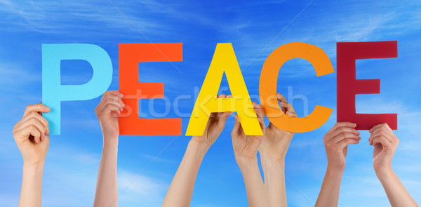 Hands Hold Colorful Straight Word Peace Blue Sky Stock photo © Nelosa