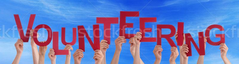 Sok emberek piros szó önkéntesség kék ég Stock fotó © Nelosa