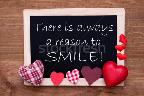 Iskolatábla textil szívek idézet állandóan mosoly Stock fotó © Nelosa