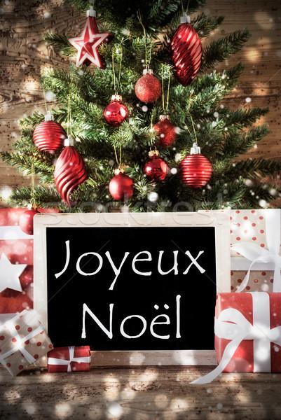 Tree With Bokeh Effect, Joyeux Noel Means Merry Christmas Stock photo © Nelosa