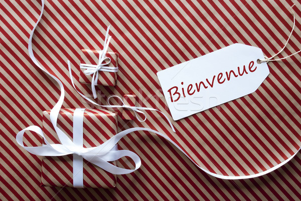 Two Gifts With Label, Bienvenue Means Welcome Stock photo © Nelosa
