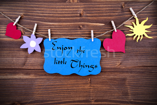 Desfrutar pequeno coisas azul etiqueta Foto stock © Nelosa