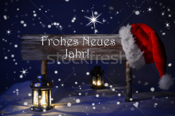 Christmas Sign Candlelight Santa Hat Frohes Neues Means New Year Stock photo © Nelosa