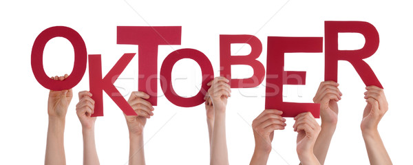 People Holding German Word Oktober Means October Stock photo © Nelosa