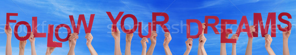 Hands Holding Red Word Follow Your Dreams Blue Sky Stock photo © Nelosa