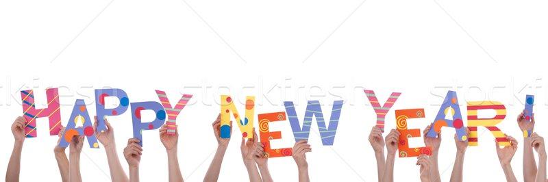 Many Hands Holding Happy New Year Stock photo © Nelosa