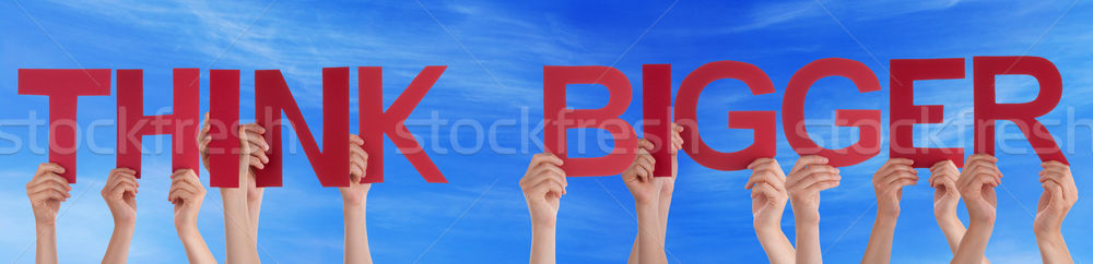 Stock photo: Hands Hold Red Straight Word Think Bigger Blue Sky