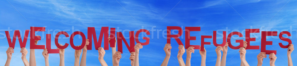 Sok emberek kezek tart szó kék ég Stock fotó © Nelosa
