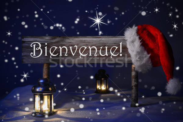 Christmas Sign Candlelight Santa Hat Bienvenue Means Welcome Stock photo © Nelosa