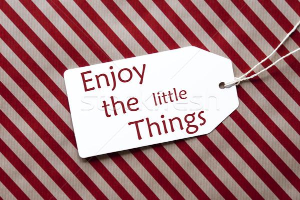Etiqueta vermelho papel de embrulho citar desfrutar pequeno Foto stock © Nelosa