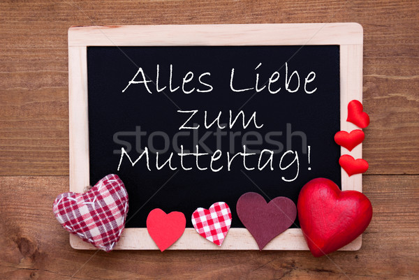 Blackboard With Textile Hearts, Text Muttertag Means Happy Mothers Day Stock photo © Nelosa