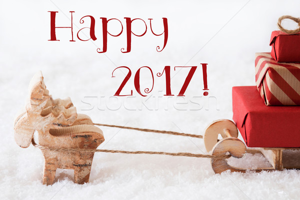 Reindeer With Sled On Snow, Text Happy 2017 Stock photo © Nelosa