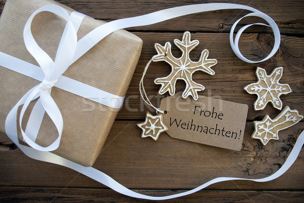 Christmas Gift and Cookies with Frohe Weihnachten Label Stock photo © Nelosa