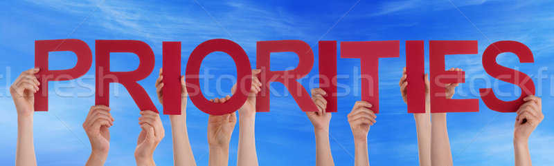 Hands Hold Red Straight Word Priorities Blue Sky Stock photo © Nelosa