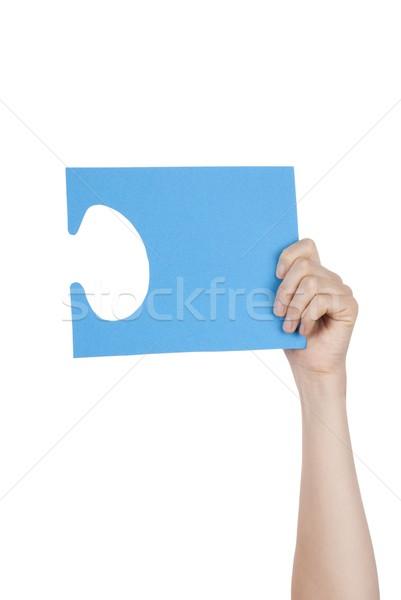 Hand Holding a Blue Puzzle Stock photo © Nelosa