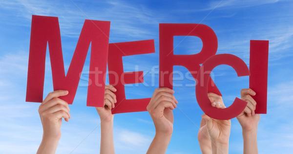 Many Hands Holding a Red merci Stock photo © Nelosa
