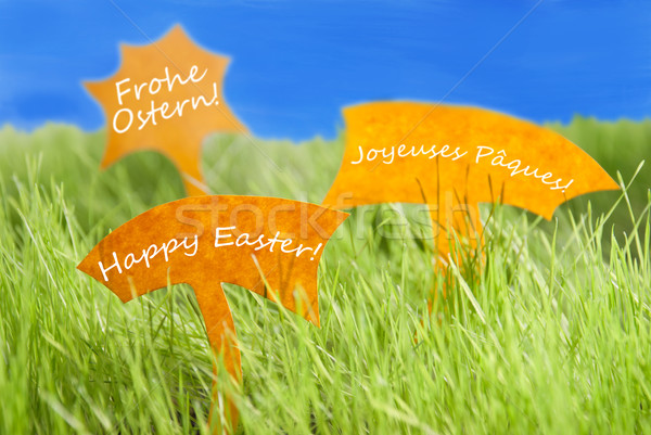 Three Labels With Happy Easter In Different Languages And Blue Sky Stock photo © Nelosa