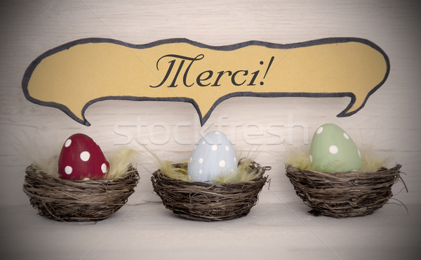 Spotlight To Three Colorful Easter Eggs With Comic Speech Balloon Merci Means Thank You Stock photo © Nelosa