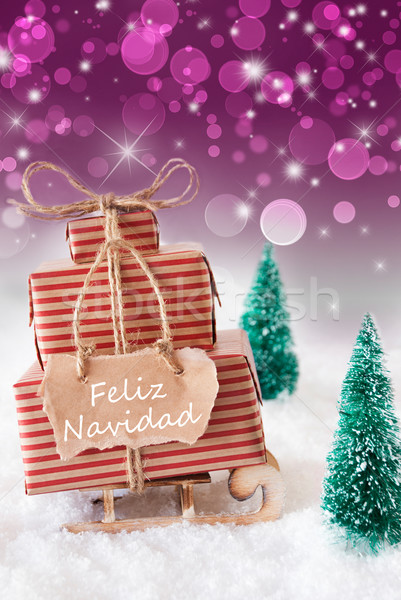 Vertical Sleigh On Purple Background, Feliz Navidad Means Merry Christmas Stock photo © Nelosa