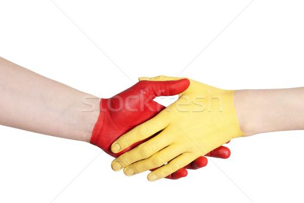 red and yellow hand handshaking Stock photo © Nelosa