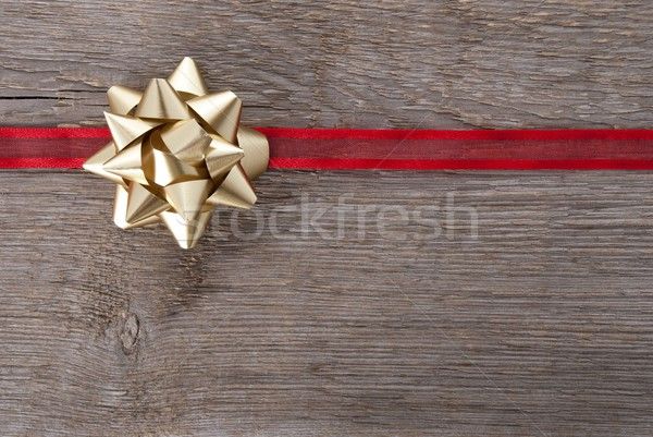 golden bow on red ribbon Stock photo © Nelosa