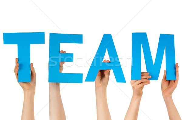 hands holding blue letters building team Stock photo © Nelosa