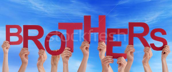 Personnes mains rouge mot frères Photo stock © Nelosa