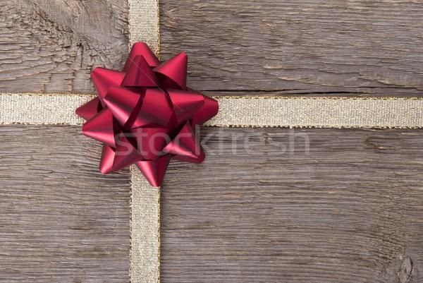 red bow on golden ribbon Stock photo © Nelosa