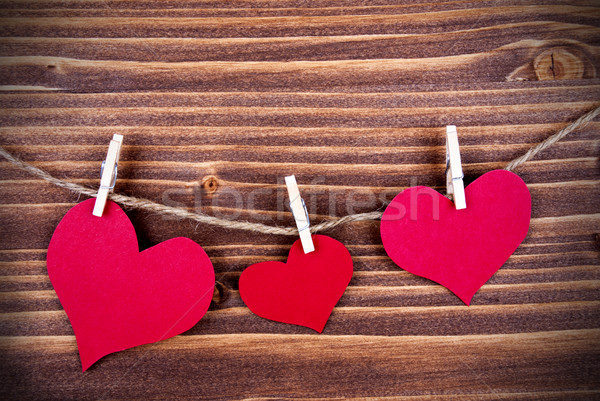 Three Hearts in different Sizes on a Line Stock photo © Nelosa