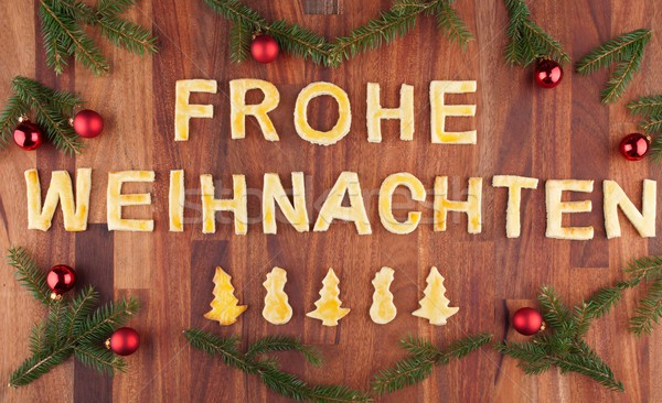 Frohe Weihnachten with decorations Stock photo © Nelosa