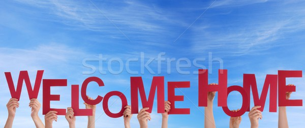 Hands Holding Welcome Home in the Sky Stock photo © Nelosa