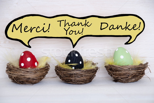 Three Colorful Easter Eggs With Comic Speech Balloon With Thank You In French English And German Stock photo © Nelosa