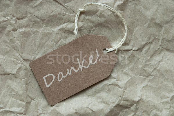 Beige Label With German Danke Means Thank You Paper Background Stock photo © Nelosa