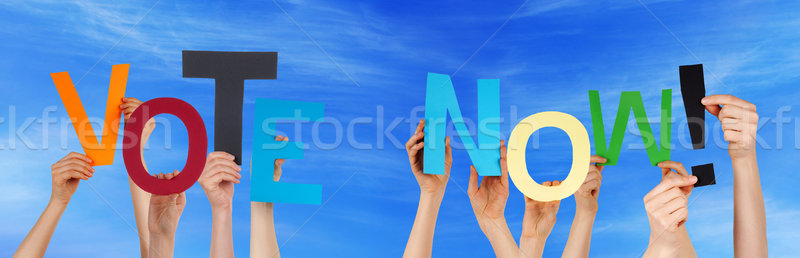 People Hands Holding Colorful Word Vote Now Blue Sky Stock photo © Nelosa