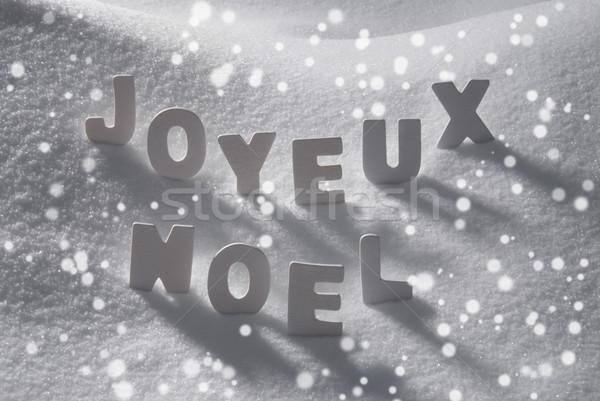 White Word Joyeux Noel Means Merry Christmas On Snow, Snowflakes Stock photo © Nelosa