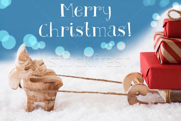 Rena luz azul texto alegre natal alce Foto stock © Nelosa