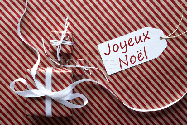 Two Gifts With Label, Joyeux Noel Means Merry Christmas Stock photo © Nelosa