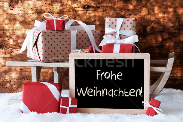 sleigh with gifts snow bokeh frohe weihnachten means. Black Bedroom Furniture Sets. Home Design Ideas